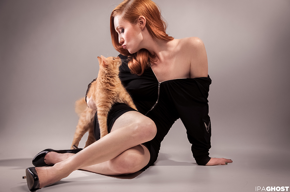 That Redhead with a ginger kitty cat.